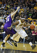 January 12 2010: Iowa Hawkeyes forward Melsahn Basabe (1) drives past Northwestern Wildcats forward John Shurna (24) during the first half of an NCAA college basketball game at Carver-Hawkeye Arena in Iowa City, Iowa on January 12, 2010. Northwestern defeated Iowa 90-71.