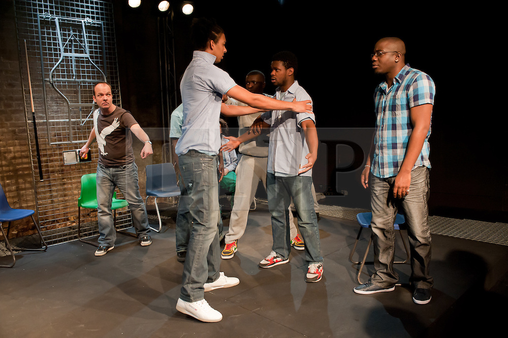 "© Copyright licensed to London News Pictures. 12/11/2010. ""Inside"" by Philip Osment, presented by Playing Out at the Roundhouse, Camden, London. Based on the real experiences of young fathers in prison, the play deals with big questions surrounding relationships, both with their own fathers and with their children. In this scene, a fight breaks out. The cast: Jim Pope, Andre Skeete, Ayo Bodunrin, Kyle Thorne, Michael Amaning, Darren Douglas, Segun Olaiya, Jacob James Beswick, Tarkan Cetinkaya."