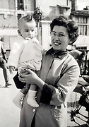 happy smiling mother with toddler baby France 1958