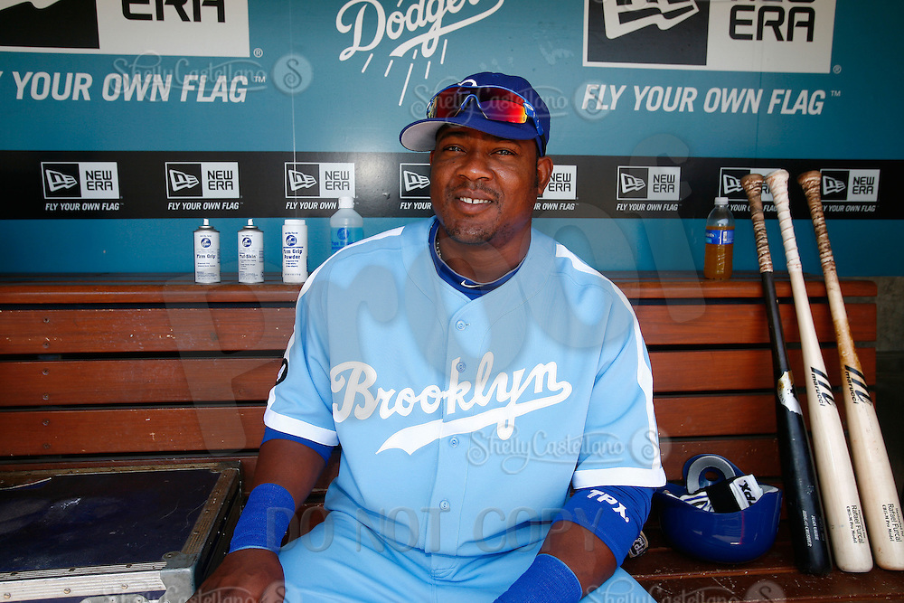 4 May 2011: #5 Juan Uribe sits in the dugout wearing the throwback uniform.  He thinks they are cool.  The Cubs defeated the Dodgers 5-1 during a Major League Baseball game at Dodger Stadium in Los Angeles, California.  Dodgers players are wearing Brooklyn Dodger 1940's throwback jersey uniforms and the Chicago Cubs are also wearing throwback retro jersey uniforms. **Editorial Use Only**
