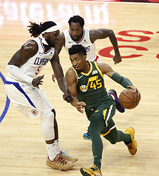 January 16, 2019 - Los Angeles, California, U.S - Utah Jazz's Donovan Mitchell (45) drives against Los Angeles ClippersÃ• Montrezl Harrell (5) during an NBA basketball game between Los Angeles Clippers and Utah Jazz Wednesday, Jan. 16, 2019, in Los Angeles. (Credit Image: © Ringo Chiu/ZUMA Wire)