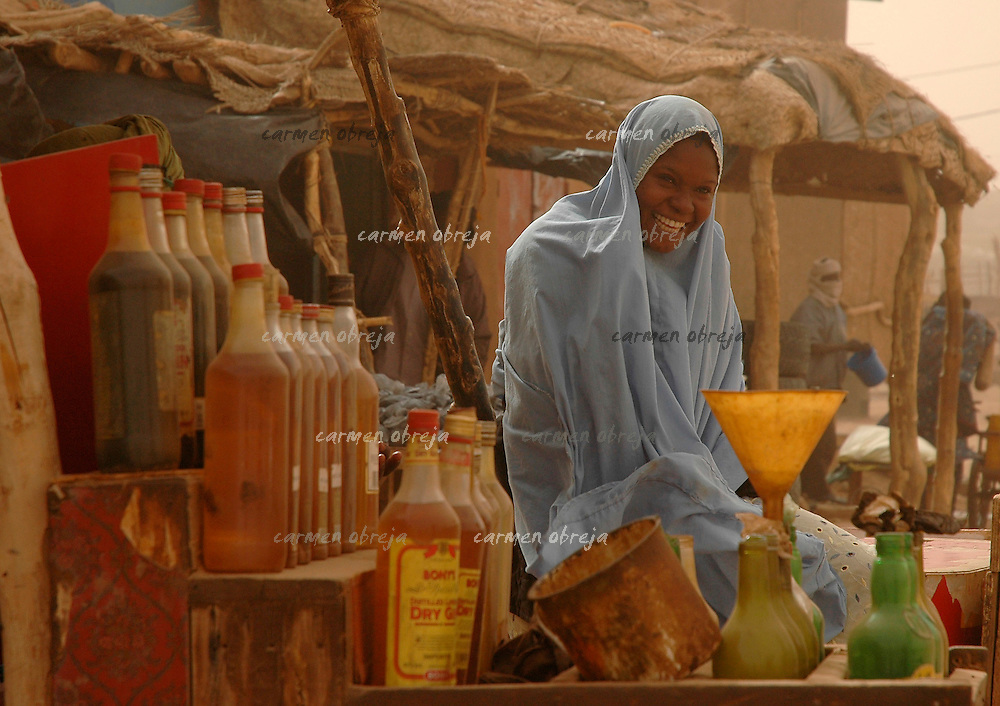 oil seller during Harmattam wind