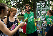 AUGUST 26, 2018  ATHENS, OHIO:<br /> John Miller, with Give Volunteers, hands out flyers to new freshman students at his recruitment table on College Green as new freshman students walk through a variety of recruitment tables from other organizations on the OU campus trying to get them to join after the freshman convocation at Ohio University on August 26, 2018 in Athens, Ohio.