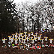 Twenty-seven wooden angel figures placed in a wooded area beside the road in Sandy Hook after the mass shootings at Sandy Hook Elementary School, Newtown, Connecticut, USA. 17th December 2012. Photo Tim Clayton