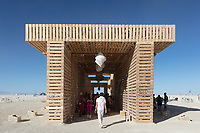 The Temple of Direction by: Geordie Van Der Bosch from: San Francisco, CA year: 2019<br /> <br /> The Temple of Direction is organized linearly. It recreates a restricted passage which expands in the center into a large hall. This is a response to the openness of the playa; it creates a space traveled end to end; versus wandering an open plan; this temple provides direction and focus. Linearity also reflects the passage of life; all lives have a beginning, a middle and an end which metaphorically is included in this temple's form. Following this metaphor a variety of spaces are created; narrow spaces and wide spaces, dark spaces and bright spaces. Tunnels create intimate experiences with shade.. A large central hall expands in width and height providing a bright area suitable for gatherings. URL: https://www.templeofdirection.org Contact: templeofdirection@gmail.com
