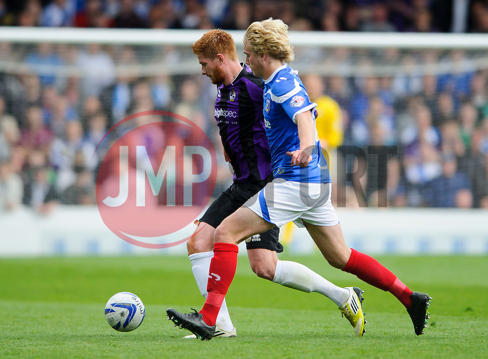 Matt Harrold (ENG) of Bristol Rovers is challenged by Jack Whatmough (ENG) of Portsmouth - Photo mandatory by-line: Rogan Thomson/JMP - 07966 386802 - 19/04/2014 - SPORT - FOOTBALL - Fratton Park, Portsmouth - Portsmouth FC v Bristol Rovers - Sky Bet Football League 2.