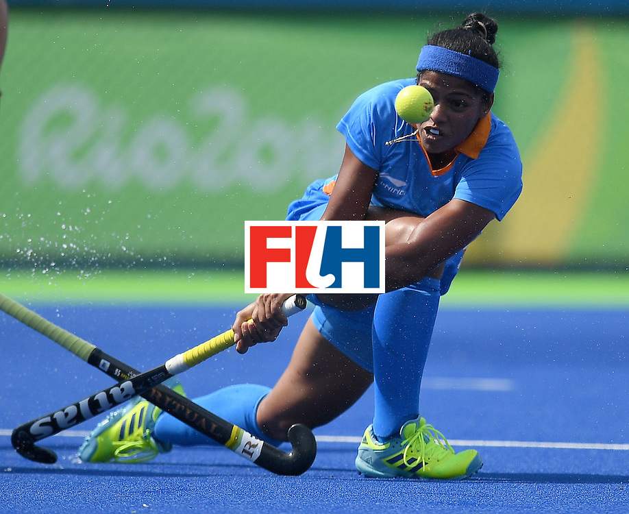 India's Deepika Deepika hits the ball during the women's field hockey Japan vs India match of the Rio 2016 Olympics Games at the Olympic Hockey Centre in Rio de Janeiro on August, 7 2016. / AFP / MANAN VATSYAYANA        (Photo credit should read MANAN VATSYAYANA/AFP/Getty Images)