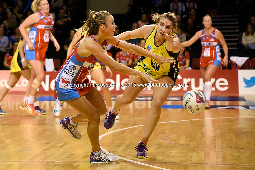 Swifts' Paige Hadley (L) makes a pass with Pulse's Te Huinga Reo Selby-Rickit in defense during the ANZ Championship - Pulse v Swifts netball match at the TSB Arena in Wellington on Saturday the 25th of April 2015. Photo by Marty Melville / www.Photosport.co.nz