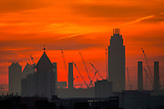 UNITED KINGDOM, London: 19 April 2018 A red sky looms behind the chimneys of Battersea Power Station this morning before the sun rises on what will be yet another warm day. Londoners will be enjoying the weather again today as high temperatures are set to continue in the capital. Rick Findler / Story