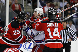 Feb 9, 2009; Newark, NJ, USA; New York Rangers center Brandon Dubinsky (17) hits New Jersey Devils defenseman Johnny Oduya (29) during the third period at the Prudential Center. The Devils defeated the Rangers 3-0.