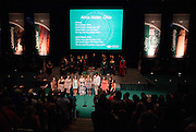 The Ohio University Women's Chorale, Title IX, performs the university alma mater during the New Student Convocation on Aug. 24, 2014. Photo by Lauren Pond
