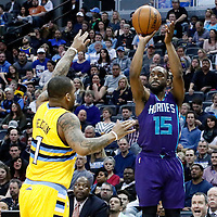 04 March 2017: Charlotte Hornets guard Kemba Walker (15) takes a jump shot over Denver Nuggets guard Jameer Nelson (1) during the Charlotte Hornets 112-102 victory over the Denver Nuggets, at the Pepsi Center, Denver, Colorado, USA.