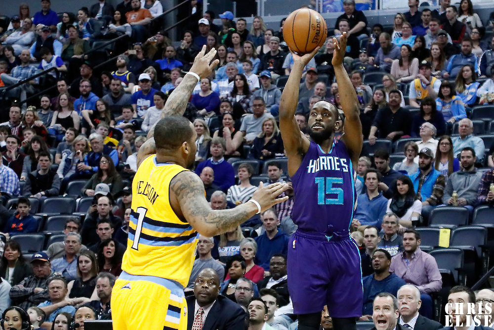 04 March 2017: Charlotte Hornets guard Kemba Walker (15) takes a jump shot over Denver Nuggets guard Jameer Nelson (1) during the Charlotte Hornets 112-102 victory over the Denver Nuggets, at the Pepsi Center, Denver, Colorado, USA.