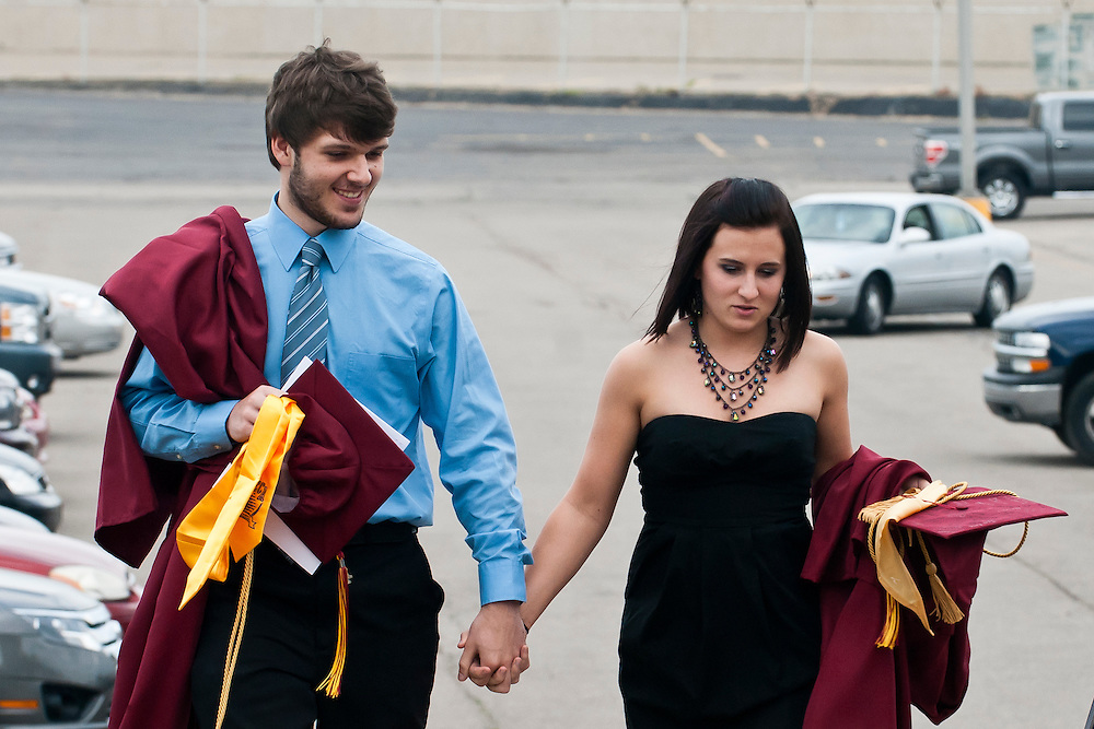 Lathan Goumas | MLive.com..Class president Griffin Haskins and Hanna Westerby walk up the stairs before entering Perani Arena for the 2012 Davison High School commencement ceremony in Flint, Mich. on Monday June 11, 2012.