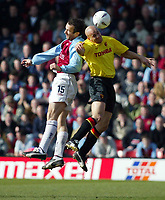 Photo: Scott Heavey<br />Watford V Burnley. 09/03/03.<br />Graham Branch of Burnley (left) outjumps Paolo Vernazza during this FA Cup quarter final between these two first division teams.