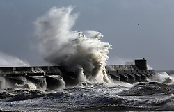 Rough seas pound the sea wall of Brighton Marina as the south coast braces itself for the storm, Sunday, 27th October 2013. Picture by Stephen Lock / i-Images