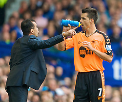 LIVERPOOL, ENGLAND - Sunday, August 30, 2009: Wigan Athletic's Paul Scharner is given instructions by manager Roberto Martinez during the Premiership match against Everton at Goodison Park. (Photo by David Rawcliffe/Propaganda)