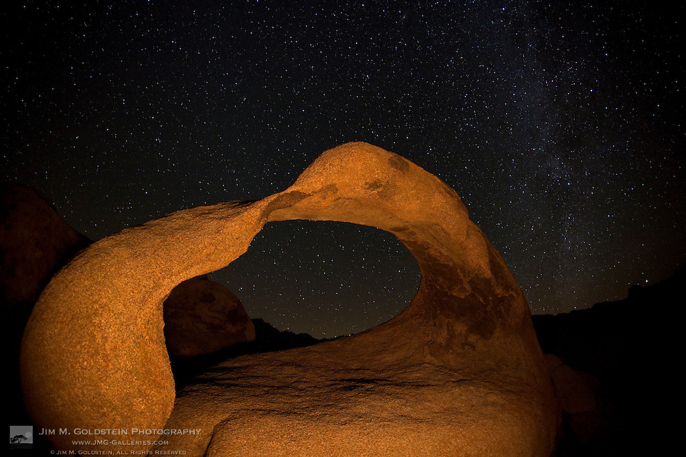 An arm of the Milky Way extends above Mobius arch - Alabama  Hills, California