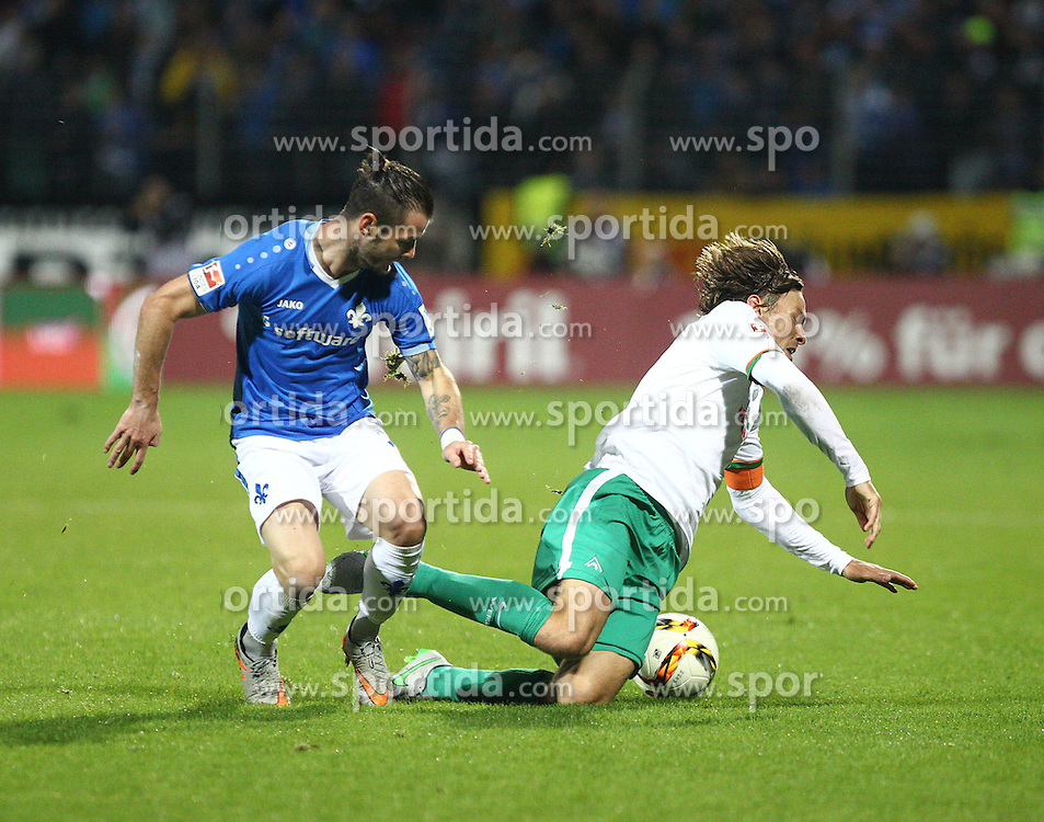22.09.2015, Merck Stadion am Boellenfalltor, Darmstadt, GER, 1. FBL, SV Darmstadt 98 vs SV Werder Bremen, 6. Runde, im Bild Marcel Heller (SV Darmstadt 98) im Zweikampf mit Clemens Fritz (SV Werder Bremen) // during the German Bundesliga 6th round match between SV Darmstadt 98 and SV Werder Bremen at the Merck Stadion am Boellenfalltor in Darmstadt, Germany on 2015/09/22. EXPA Pictures &copy; 2015, PhotoCredit: EXPA/ Eibner-Pressefoto/ Bermel<br /> <br /> *****ATTENTION - OUT of GER*****