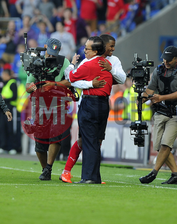 Cardiff City's Fraizer Campbell is congratulated by Cardiff City owner Tan Sri Vincent Tan on the final whistle - Photo mandatory by-line: Joe Meredith/JMP - Tel: Mobile: 07966 386802 25/08/2013 - SPORT - FOOTBALL - Cardiff City Stadium - Cardiff -  Cardiff City V Manchester City - Barclays Premier League