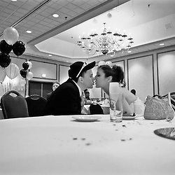 "After getting married earlier in the day, newlyweds, Jessica Dalton (right, age 17), and Casey Dalton (left, age 17), share a late night kiss during the waning hours of William Fleming's ""A Night in Paris"" prom."