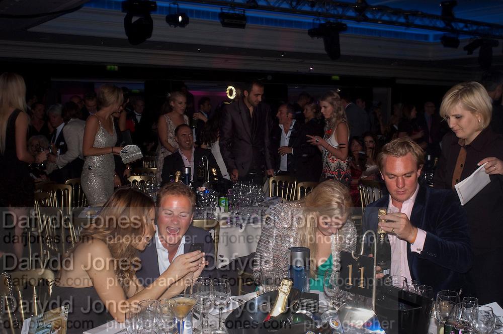 GUY PELLY; ROSIE FAWEHIMI, The London Bar and Club awards. Intercontinental Hotel. Park Lane, London. 6 June 2011. <br /> <br />  , -DO NOT ARCHIVE-© Copyright Photograph by Dafydd Jones. 248 Clapham Rd. London SW9 0PZ. Tel 0207 820 0771. www.dafjones.com.
