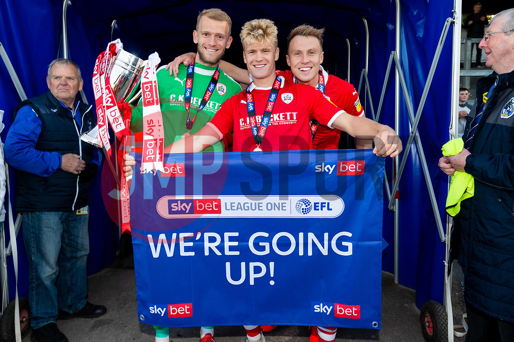 Adam Davies of Barnsley, Cameron McGeehan of Barnsley and Cauley Woodrow celebrates after the final whistle of the match after Barnsley secure automatic promotion to the Sky Bet  Championship  - Mandatory by-line: Ryan Hiscott/JMP - 04/05/2019 - FOOTBALL - Memorial Stadium - Bristol, England - Bristol Rovers v Barnsley - Sky Bet League One