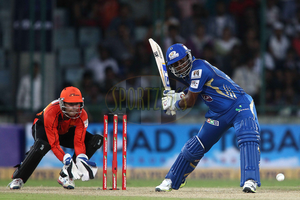Dwayne Smith of Mumbai Indians looks to attack a delivery during match 19 of the Karbonn Smart Champions League T20 between the Perth Scorchers and the Mumbai Indians held at the Feroz Shah Kotla Stadium, Delhi on the 2nd October 2013<br /> <br /> <br /> Photo by Shaun Roy-CLT20-SPORTZPICS <br /> <br /> Use of this image is subject to the terms and conditions as outlined by the CLT20. These terms can be found by following this link:<br /> <br /> http://sportzpics.photoshelter.com/image/I0000NmDchxxGVv4