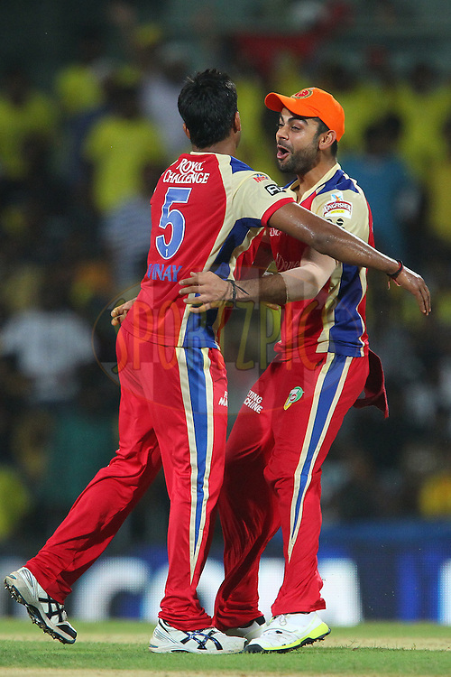 Vinay Kumar celebrates the wicket of Michael Hussey with Virat Kohli during match 16 of the Pepsi Indian Premier League between The Chennai Superkings and the Royal Challengers Bangalore held at the MA Chidambaram Stadiumin Chennai on the 13th April 2013..Photo by Ron Gaunt-IPL-SPORTZPICS  .. .Use of this image is subject to the terms and conditions as outlined by the BCCI. These terms can be found by following this link:..http://www.sportzpics.co.za/image/I0000SoRagM2cIEc