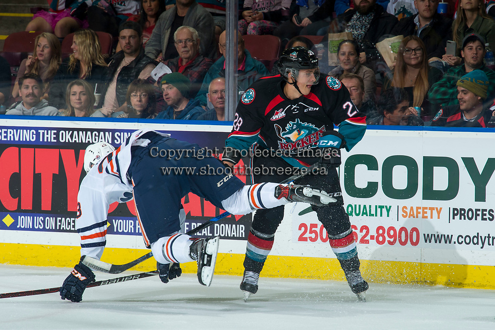 KELOWNA, CANADA - SEPTEMBER 22: Ryley Appelt #23 of the Kamloops Blazers falls to the ice after a check by Leif Mattson #28 of the Kelowna Rockets during first period  on September 22, 2018 at Prospera Place in Kelowna, British Columbia, Canada.  (Photo by Marissa Baecker/Shoot the Breeze)  *** Local Caption ***