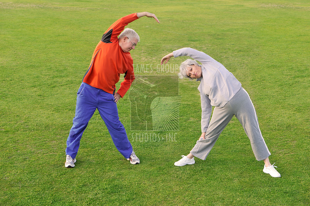 Senior couple warming up outside for an exercise routine