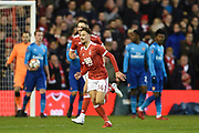 Nottingham Forest midfielder Matty Cash (14) celebrates after Forest scores a goal to make it 1-0 during the The FA Cup 3rd round match between Nottingham Forest and Arsenal at the City Ground, Nottingham, England on 7 January 2018. Photo by Jon Hobley.