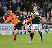 Dundee United's Paul Dixon tackles Dundee's Paul McGowan - Dundee United v Dundee at Tannadice Park in the SPFL Premiership<br /> <br />  - © David Young - www.davidyoungphoto.co.uk - email: davidyoungphoto@gmail.com