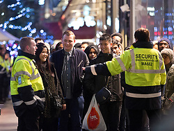 © Licensed to London News Pictures. 26/12/2014. Shoppers queue outside Westfield Stratford City, east London, before 7am for the Boxing Day sales today (26/12/2014.). Photo credit : LNP