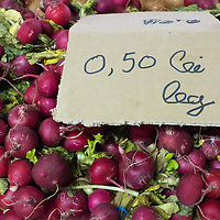 TIMISOARA, ROMANIA - APRIL 21:  A sign shows the price of radishes in Romanian Leu on April 21, 2013 in Timisoara, Romania.  Romania has abandoned a target deadline of 2015 to switch to the single European currency and will now submit to the European Commission a programme on progress towards the adoption of the Euro, which for the first time will not have a target date. (Photo by Marco Secchi/Getty Images)