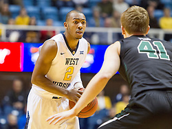 Nov 20, 2015; Morgantown, WV, USA; West Virginia Mountaineers guard Jevon Carter looks to pass around Stetson Hatters guard Brian Pegg during the first half at WVU Coliseum. Mandatory Credit: Ben Queen-USA TODAY Sports