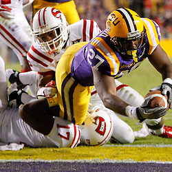 November 12, 2011; Baton Rouge, LA, USA;  LSU Tigers running back Kenny Hilliard (27) dives into the endzone for a touchdown during the second half of a game against the Western Kentucky Hilltoppers at Tiger Stadium.  Mandatory Credit: Derick E. Hingle-US PRESSWIRE