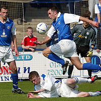 Queen of the South v St Johnstone...01.05.04  <br />Eric Paton is stopped by Mark Baxter<br /><br />Picture by Graeme Hart.<br />Copyright Perthshire Picture Agency<br />Tel: 01738 623350  Mobile: 07990 594431