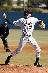Virginia Cavaliers pitcher Jacob Thompson (25) makes a pickoff move against Bucknell.  The Virginia Cavaliers Baseball Team defeated the Bucknell University Bisons 3-0 in the first game of a doubleheader at Davenport Field in Charlottesville, VA on February 24, 2007.