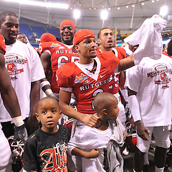 Dec 20, 2009; St. Petersburg, Fla., USA; Rutgers wide receiver Tim Brown (2) celebrates with his children following Rutgers' 45-24 victory over Central Florida in the St. Petersburg Bowl at Tropicana Field.