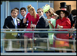 Image ©Licensed to i-Images Picture Agency. 21/06/2014. Ascot, United Kingdom.Princess Beatrice gets a helping hand on the balcony of her box as her and  Princess Eugenie (right) watch the racing on  Day 5 of Royal Ascot. Ascot Racecourse. Picture by Andrew Parsons / i-Images