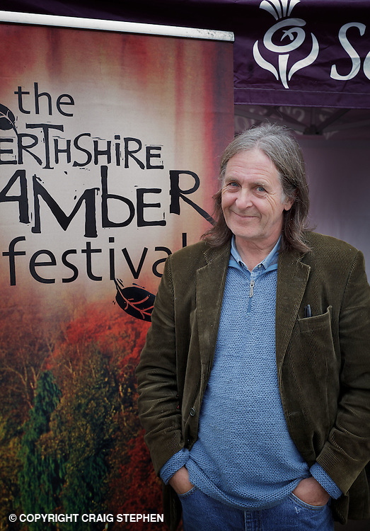 """One of Scotland's most popular musicians, Dougie MacLean, who is perhaps most famous for writing the anthem """"Caledonia"""", made a personal appearances at six VisitScotland Information Centres across Perthshire in a whistle stop tour of the region to promote the Perthshire Amber Festival. He is seen here visiting the Dunkeld centre."""