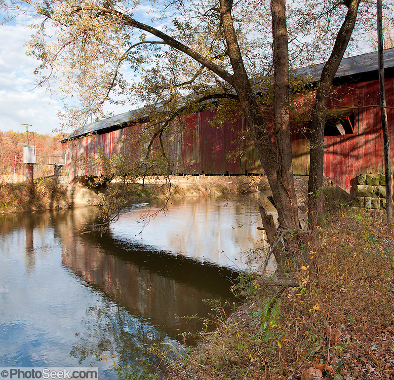 Roseville Covered Bridge (263 feet long) was built in Burr Arch style over Big Raccoon Creek in 1910 by Van Fossen in Parke County, Indiana, USA. Panorama stitched from 3 photos.