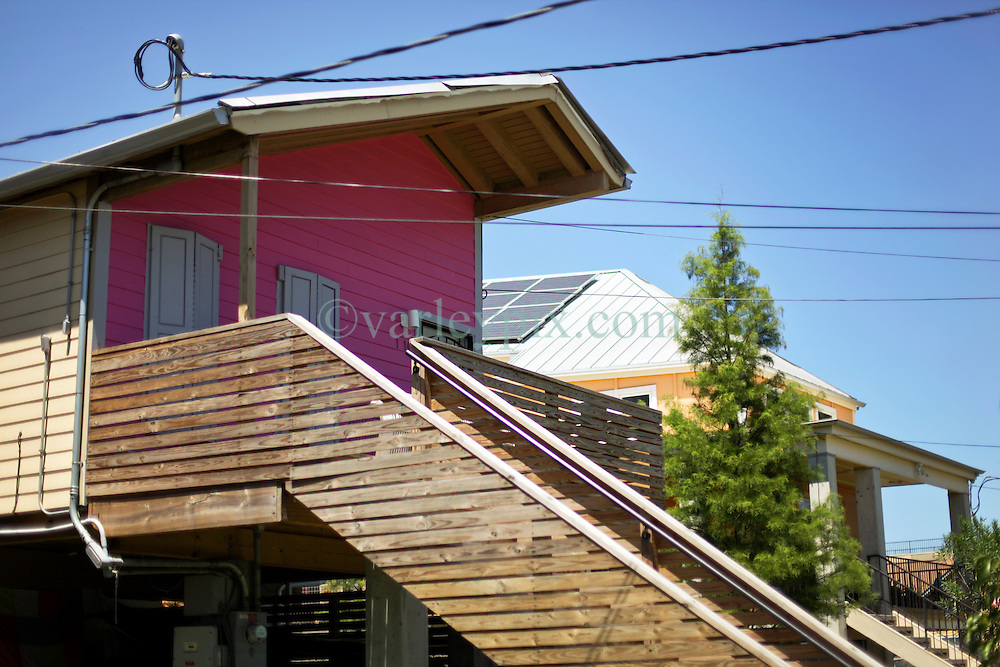 26 August 2015. New Orleans, Louisiana. <br /> Hurricane Katrina revisited. <br /> Rebuilding the Lower 9th Ward. <br /> 'Make it Right' houses on Tennessee Street. Eco friendly 'Make it Right' homes inspired by actor Brad Pitt continue to provide hope for the rebirth of the community following the devastation of hurricane Katrina a decade earlier.<br /> Photo credit&copy;; Charlie Varley/varleypix.com.