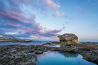 Purple tinged clouds herald dusk over the exposed intertidal rock flats of the De Hoop Marine Protected Area, Western Cape, South Africa