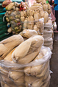 Dried tamale corn husks at Benito Juarez market in Oaxaca, Mexico.