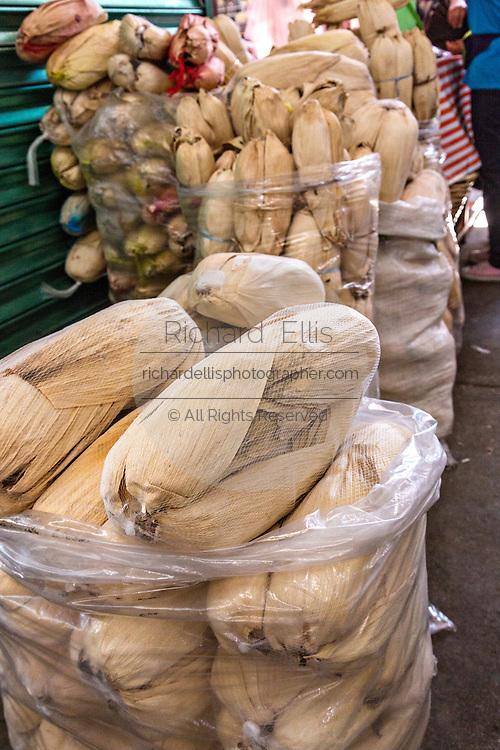 Dried tamale corn husks at Benito Juarez market in Oaxaca, Mexico.