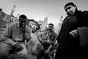 Cairo, Egypt, The City of the Dead, 2000 -  A family sits me down for a chat and tea amoung the grave markers near their living space.
