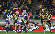 Warriors' Manu Vatuvei is tackled during the 2013 NRL season. Vodafone Warriors v Canterbury Bulldogs at Westpac Stadium, Wellington, New Zealand on Saturday 11 May 2013. Photo: Justin Arthur / photosport.co.nz