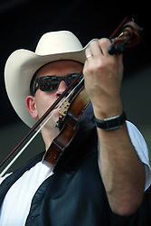 05 May 2012. New Orleans, Louisiana,  USA. .New Orleans Jazz and Heritage Festival. .Jason Roberts with the American country band 'Asleep at the Wheel,' winners of 9 Grammy awards..Photo; Charlie Varley.